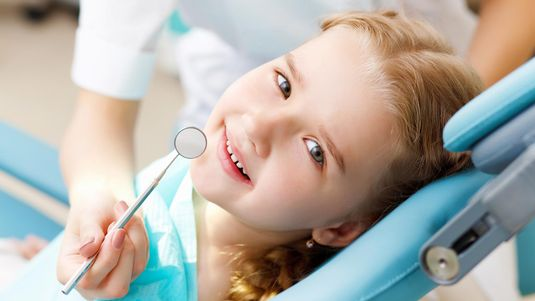 A young girl at a dental practice